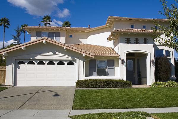 white suburban house with blue skies