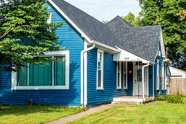 blue house with green grass