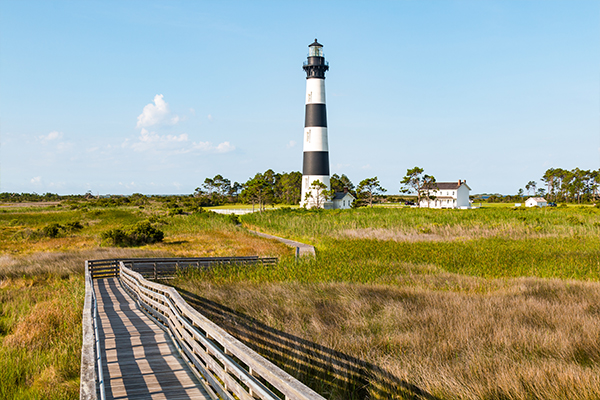 Boardwalk to lighthouse on a sunny day