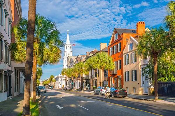 Historic houses downtown Charleston with palm trees