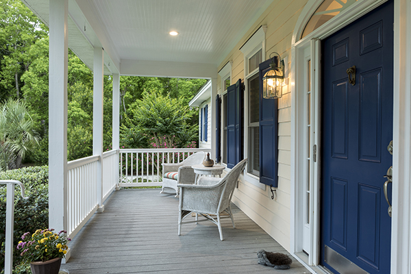 Southern front porch with chairs and blue door