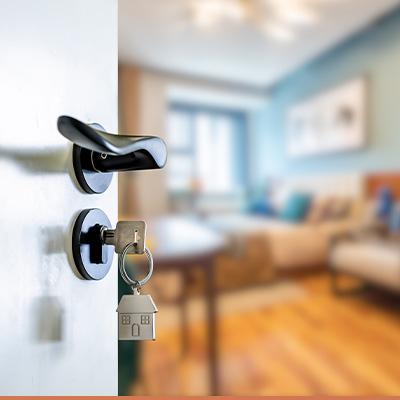 Key in door, door opening to house