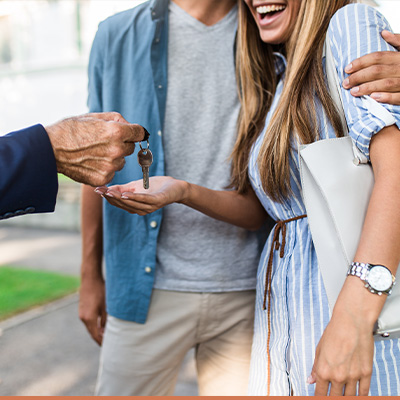 Young couple getting keys to their new house