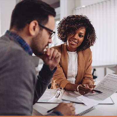 Finance advisor explains documents to client