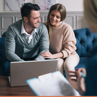 Young couple meeting with realtor in living room