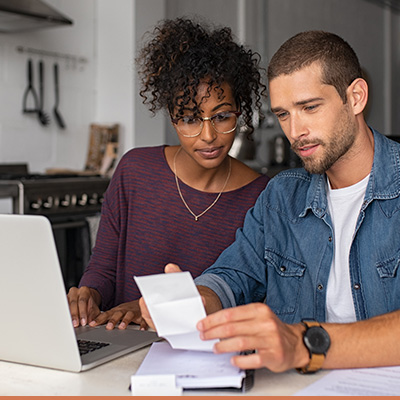 Couple at table reviewing their finances