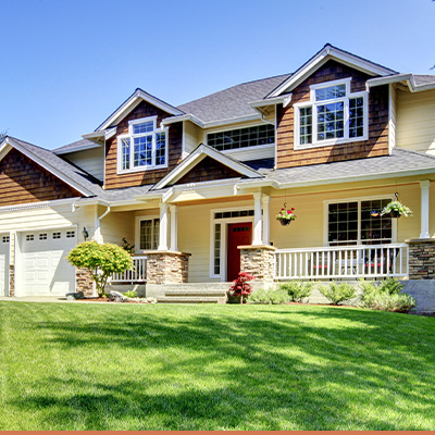 Exterior single family home with green grass and blue skies