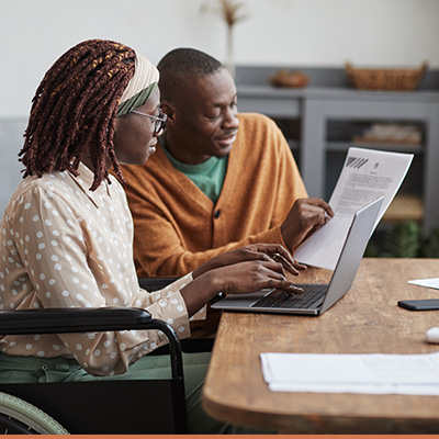 Woman working with lender to discuss paperwork