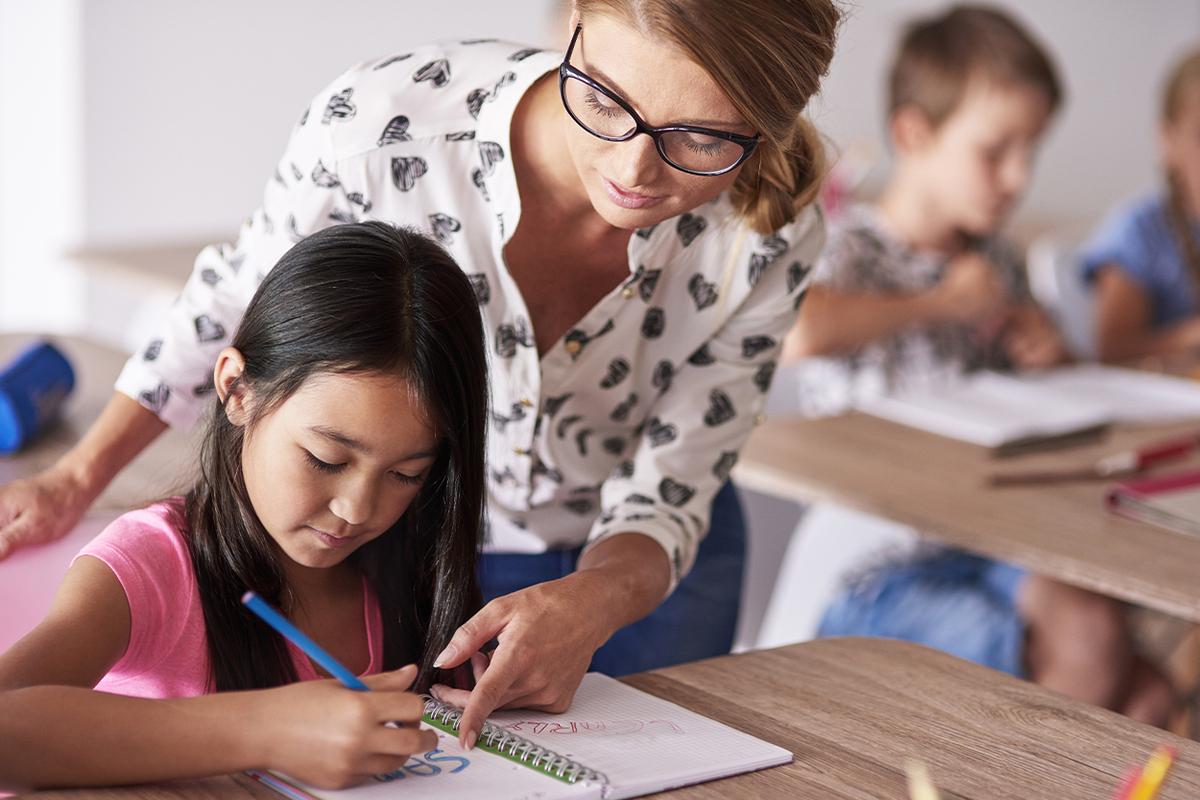 teacher teaching a student
