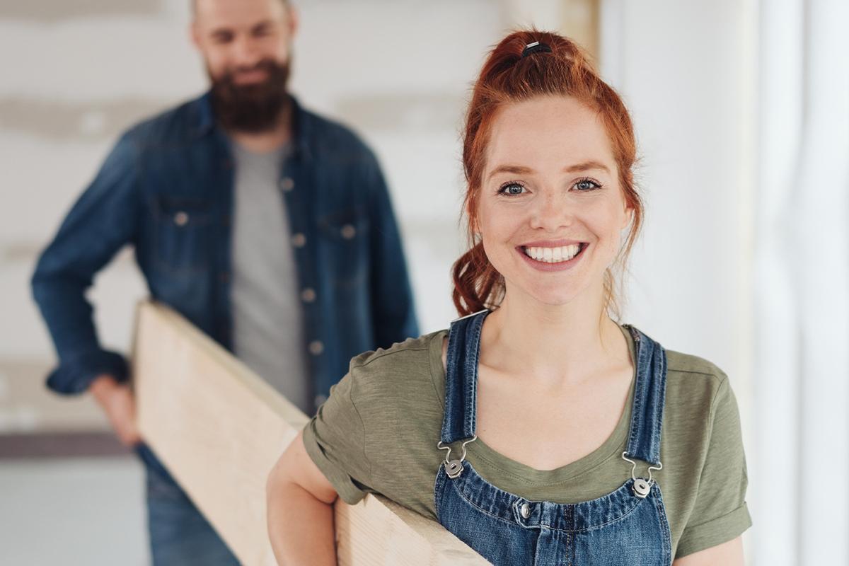 woman holding lumber