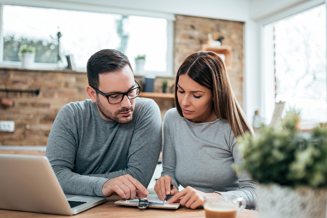 Couple at table reviewing paperwork