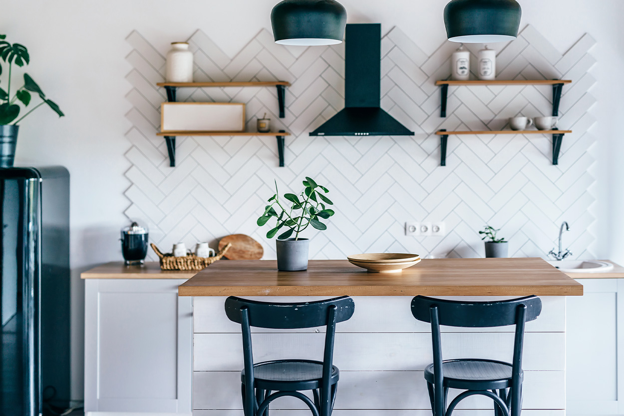 Renovated kitchen with white tile and black hardware