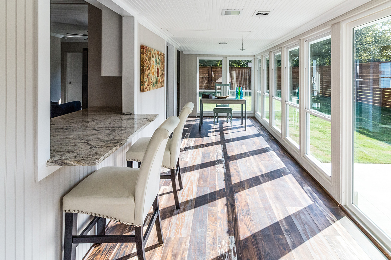 Remodeled porch with hardwood and tall windows