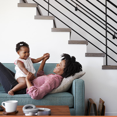 Mom and daughter on couch in livingroom