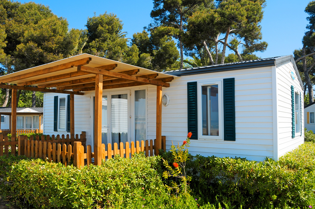 Mobile home exterior with wood pergola