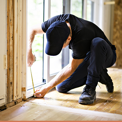 Man inspecting home