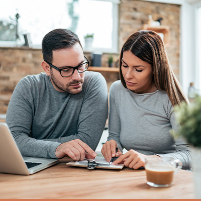Young couple reviewing paperwork together