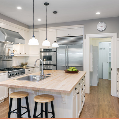 Clean updated kitchen with tasteful decor on the counter