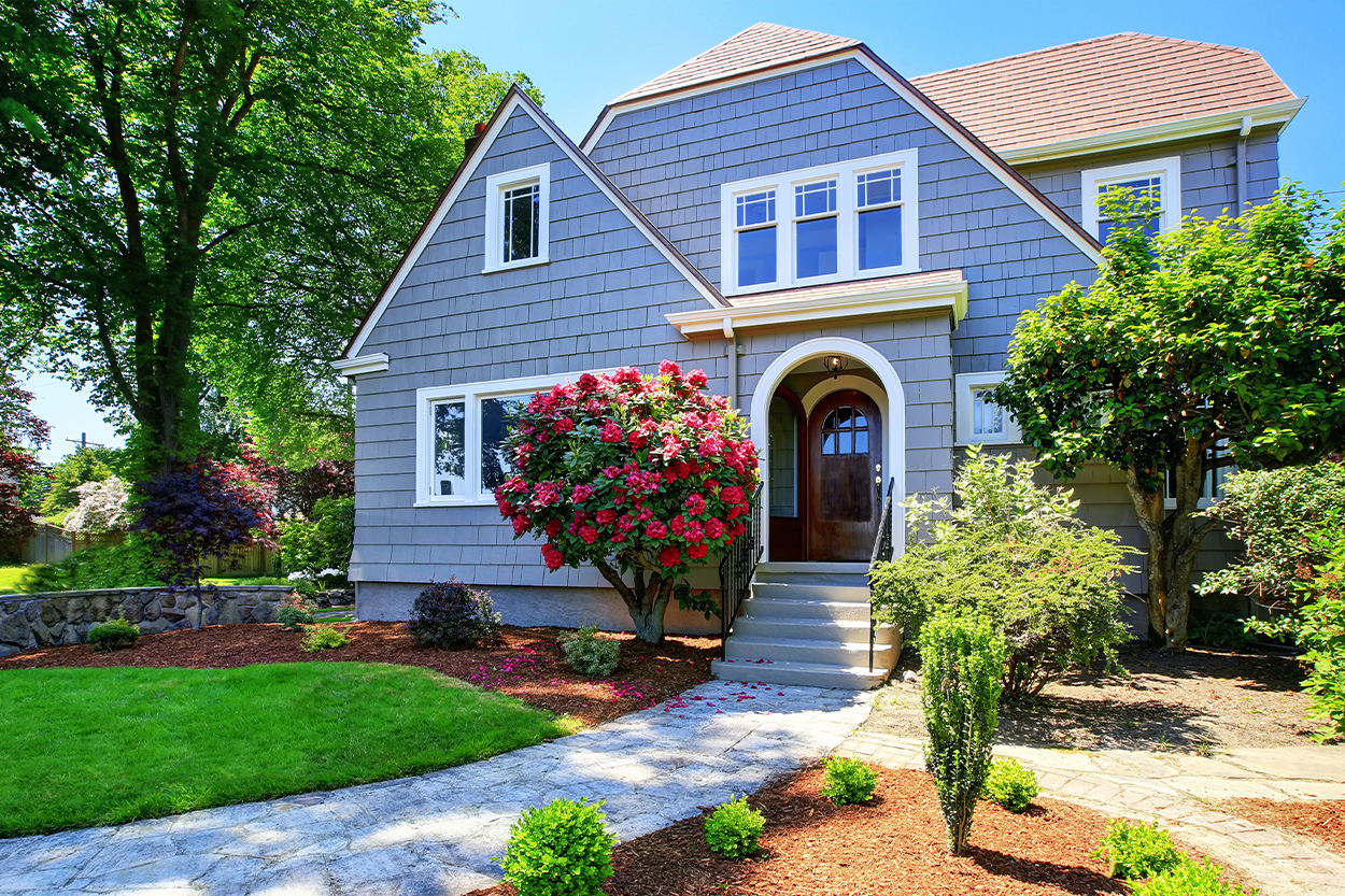 American craftsman house exterior with spring flowers in bloom
