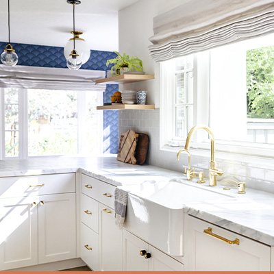 Renovated kitchen with windows and floating shelves