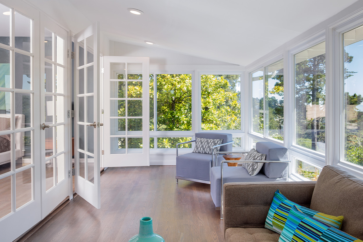 Remodeled Sunroom with tall white trim windows