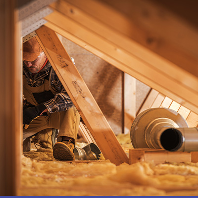 Man working in attic with insulation