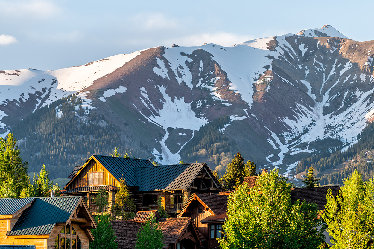 View of houses in Colorado with mountains in the background