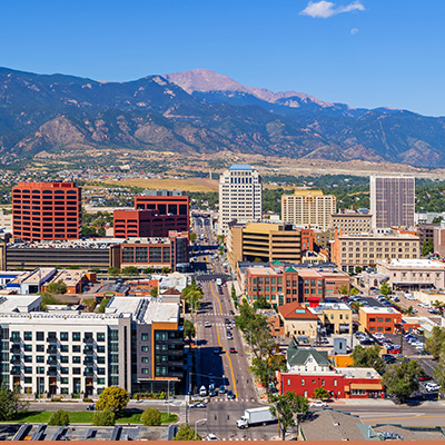 Aerial view of Colorado Springs, Colorado with mountains in the background