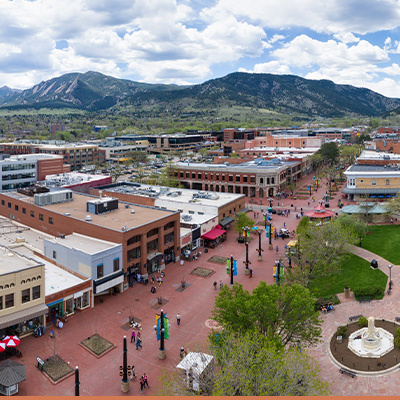 Aerial view of Boulder, Colorado with mountains in background