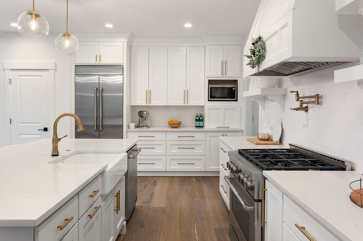 kitchen with hardwood floors and white cabinets and countertops