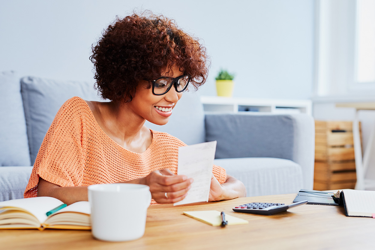 Young woman reviewing finances at table