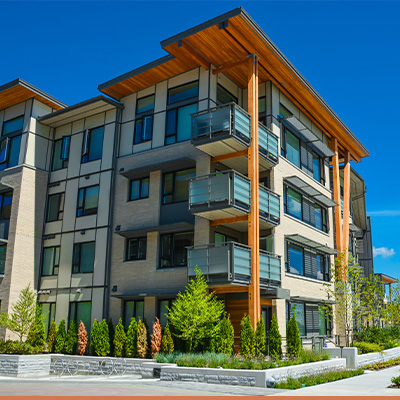 Exterior view of condo building with blue skies